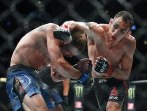 ASSOCIATED PRESS                                 Tony Ferguson, right, punches Donald Cerrone, left, during their lightweight mixed martial arts bout at UFC 238 in Chicago on June 8. Ferguson and Justin Gaethje will headline the mixed martial arts card at UFC 249.