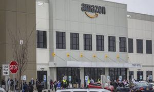 ASSOCIATED PRESS                                 Workers at Amazon's fulfillment center in Staten Island, N.Y., gather outside to protest work conditions in the company's warehouse on March 30.