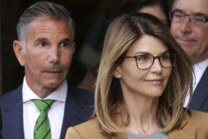 ASSOCIATED PRESS / APRIL 3, 2019                                 Actress Lori Loughlin, front, and her husband, clothing designer Mossimo Giannulli, left, departed federal court in Boston after a hearing in a nationwide college admissions bribery scandal.