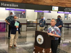 DENNIS ODA / DODA@STARADVERTISER.COM                                 Gov. David Ige speaks at Daniel K. Inouye International Airport today.