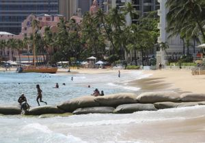 JAMM AQUINO / JULY 30                                 Beachgoers enjoy the ocean at a sparsely crowded Waikiki Beach in Waikiki. Health Department Director Bruce Anderson said most of the new coronavirus cases have been associated with social gatherings.