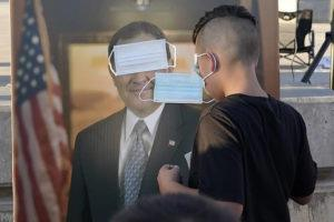 "ASSOCIATED PRESS                                 Children played ""pin the mask on Gov. Gary Herbert,"" Sept. 5, during a ""Trash Your Mask Protest"" rally hosted by the Utah Business Revival at the Utah State Capitol in Salt Lake City. The event was held to protest Herbert's order requiring all K-12 schools in Utah to require face coverings to stop the spread of the coronavirus."