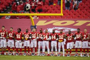 ASSOCIATED PRESS                                 Kansas City Chiefs players stand for a presentation on social justice before Thursday's game against the Houston Texans.