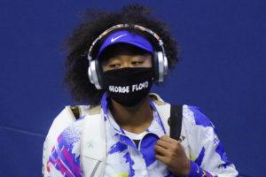 """ASSOCIATED PRESS                                 Naomi Osaka, of Japan, wore a protective mask, Sept. 8, due to the COVID-19 virus outbreak, featuring the name """"George Floyd,"""" while arriving on court to face Shelby Rogers, of the United States, during the quarterfinal round of the U.S. Open tennis championships, in New York."""