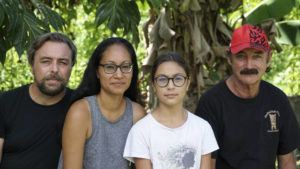 TERAIHAU RIO VIA ASSOCIATED PRESS                                 A group who have been stranded in Tahiti, pictured from left, Benjamin Baude, Kissy Ika Chavez Baude, Gaïa Baude Ika and Thierry Gourtay in Afareaitu on Moorea Island, Tahiti, Sept. 19. A group of 25 residents from remote Easter Island has been stranded far from home for six months now.