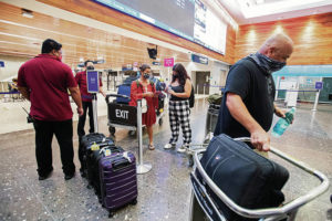 CINDY ELLEN RUSSELL / CRUSSELL@STARADVERTISER.COM                                 Above center, the Cruz family — Rosie, left, Olivia and Jason — checked in Sunday at Daniel K. Inouye International Airport for their flight back to the San Francisco Bay Area after spending most of their summer on Oahu.