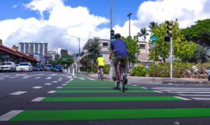 COURTESY CITY AND COUNTY OF HONOLULU                                 Bicyclists traversing the protected Pensacola bike lane, which opened today.