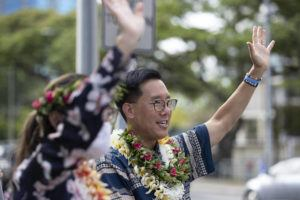 CINDY ELLEN RUSSELL / JULY 14                                 Mayoral candidate Keith Amemiya and his wife, Bonny, waved to drivers near the State Capitol.
