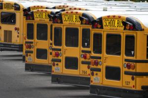 ASSOCIATED PRESS / JULY 24                                 School buses are lined up at a maintenance facility in Lorton, Va.