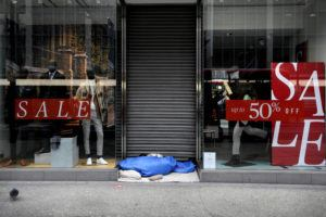 ASSOCIATED PRESS                                 A homeless person sleeps in the doorway of a closed shop on Oxford Street in London London is currently in Tier 4 with all nonessential retail closed and people have been asked to stay at home, on what is usually one of the busiest retail days of the year with the traditional Boxing Day sales in shops.
