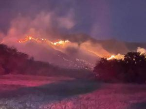 COURTESY MAUI COUNTY                                 The photo from Maui County officials shows an Olowalu brush fire Saturday night. Firefighters had the blaze 90% contained by this morning.