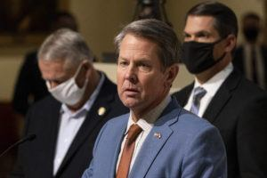 ASSOCIATED PRESS / JAN. 6                                 Georgia Gov. Brian Kemp, center, Speaker of the House David Ralston and Lt. Gov. Geoff Duncan hold a press conference Wednesday evening at the Georgia State Capitol in Atlanta, to condemn the breach of the U.S. Capitol.