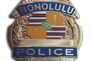 STAR-ADVERTISER / 2018                                 A Honolulu Police Department badge.