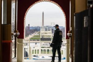 NEW YORK TIMES                                 A U.S. Capitol Police officer stands in an archway leading to the inaugural stage at the Capitol on Monday.