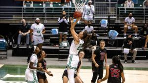 "COURTESY UNIVERSITY OF HAWAII The University of Hawaii at Manoa women's basketball team, seen here playing UH-Hilo last month, will ""temporarily pause"" team activities following a COVID-19 positive test within the program, school officials said today."