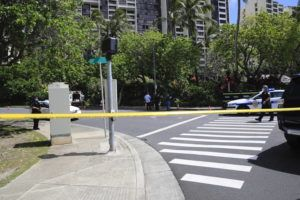 JAMM AQUINO / FEB. 23                                 Honolulu police officers on Tuesday work the scene of a fatal stabbing at Hahaione Street in Hawaii Kai.