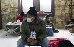 ASSOCIATED PRESS                                 People seeking shelter from sup-freezing temperatures gather at a make-shift warming shelter at Travis Park Methodist Church today in San Antonio.