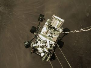 COURTESY NASA VIA AP                                 The Perseverance rover lowered towards the surface of Mars during its powered descent.