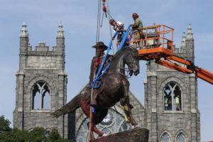 ASSOCIATED PRESS / 2020                                 Crews attach straps to the statue Confederate General J.E.B. Stuart on Monument Avenue in Richmond, Va.