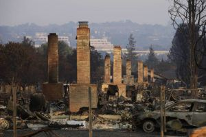 ASSOCIATED PRESS                                 A row of chimneys stand in a neighborhood devastated by the Tubbs fire near Santa Rosa, Calif., in 2017. A trust representing more than 80,000 victims of deadly wildfires ignited by Pacific Gas and Electric's rickety electrical grid is suing nearly two dozen of the utility's former executives and board members for alleged dereliction of their duty to ensure the equipment wouldn't kill people.
