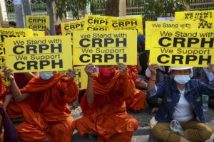 "ASSOCIATED PRESS                                 Buddhist monks display placards during an anti-coup protest in Mandalay, Myanmar. Myanmar security forces cracked down on anti-coup protesters in the country's second-largest city Mandalay on Friday, injuring at least three people, two of whom were shot in the chest by rubber bullets and another who suffered a wound on his leg. ""CRPH"" in the placards stand for ""Committee Representing Pyidaungsu Hluttaw."""