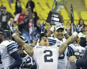 "ASSOCIATED PRESS / 2012                                 Chad Owens hosts the ""The CO2 RUN DWN,"" the Honolulu Star-Advertiser's Facebook Live sports talk show. Owens is shown here celebrating a Toronto Argonauts' victory on Nov. 18, 2012, in Montreal."