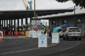 JAMM AQUINO / JAN. 18                                 Vehicles drive up at the first mass COVID-19 vaccination clinic at Pier 2 in Honolulu.