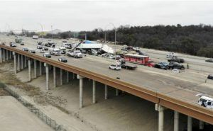 AMANDA MCCOY /STAR-TELEGRAM VIA ASSOCIATED PRESS                                 First responders worked the scene of a fatal crash on I-35 near downtown Fort Worth, today. Police said some people were killed and dozens injured in a massive crash involving 75 to 100 vehicles on an icy Texas interstate.