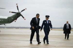 NEW YORK TIMES / 2011                                 President Barack Obama speaks with Gen. Jacqueline D. Van Ovost of the Air Force before boarding Air Force One at Andrews Air Force Base.