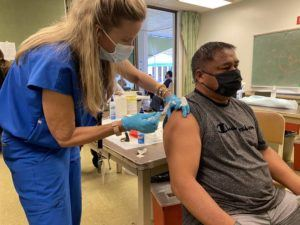 COURTESY HAWAII DEPARTMENT OF HEALTH                                 Hawaii Department of Education employee Fulton Dela Cruz receives a single-shot of the coronavirus vaccine by Johnson & Johnson today at the Windward Comprehensive Health Center in Kaneohe.