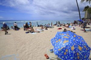 JAMM AQUINO / MARCH 29                                 Beachgoers are seen on the sand and in the ocean on Monday in Waikiki.