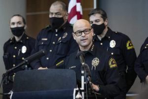 LYNDA M. GONZáLEZ/THE DALLAS MORNING NEWS VIA ASSOCIATED PRESS                                 Chief Eddie García, center, spoke with media during a press conference regarding the arrest and capital murder charges against Officer Bryan Riser at the Dallas Police Department headquarters, today, in Dallas. Riser was arrested today on two counts of capital murder in two unconnected 2017 killings that weren't related to his police work, authorities said.
