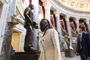ASSOCIATED PRESS                                 House Speaker Nancy Pelosi of Calif., walked through Statuary Hall, during the vote on the Democrats' $1.9 trillion COVID-19 relief bill, on Capitol Hill, Wednesday, in Washington.