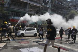 ASSOCIATED PRESS                                 An anti-coup protester discharges a fire extinguisher to counter the impact of the tear gas fired by police during a demonstration in Yangon, Myanmar, on Monday.