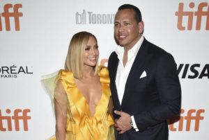 """ASSOCIATED PRESS / 2019                                 Jennifer Lopez, left, and Alex Rodriguez attend the premiere for """"Hustlers"""" on day three of the Toronto International Film Festival at Roy Thomson Hall, in Toronto."""