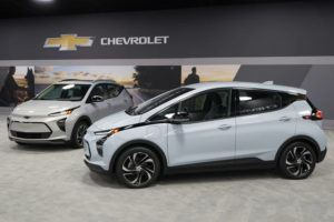 ASSOCIATED PRESS / FEBRUARY 11                                 The 2022 Bolt EV, foreground, and EUV are displayed in Milford, Mich.