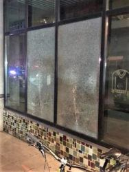 ASSOCIATED PRESS                                 This March 12 photo released by Portland Police Bureau shows smashed windows left behind by people inside the perimeter of a march by a group of about 100 hundred protesters in Portland, Ore.