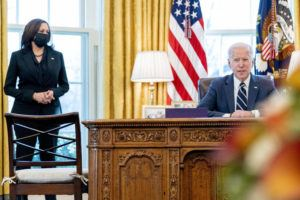 ASSOCIATED PRESS                                 President Joe Biden, accompanied by Vice President Kamala Harris, speaks before signing the American Rescue Plan, a coronavirus relief package, in the Oval Office of the White House today in Washington.