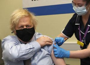 ASSOCIATED PRESS / MARCH 19                                 Britain's Prime Minister Boris Johnson receives the first dose of the AstraZeneca vaccine administered by nurse and Clinical Pod Lead, Lily Harrington at St. Thomas' Hospital in London. Johnson is one of several politicians across Europe, including French Prime Minister Jean Castex, getting a shot of the AstraZeneca vaccine on Friday.