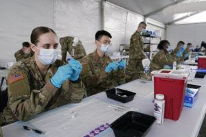 ASSOCIATED PRESS                                 Army health specialists fill syringes with the Pfizer COVID-19 vaccine in Miami on March 9. Despite the clamor to speed up the U.S. vaccination drive against COVID-19, the first three months of the rollout suggest faster is not necessarily better.
