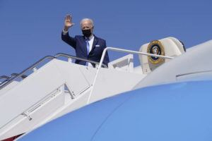ASSOCIATED PRESS                                 President Joe Biden waves as he boards Air Force One at Andrews Air Force Base, Md., today.