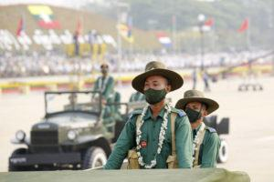 ASSOCIATED PRESS                                 Military personnel participate in a parade on Armed Forces Day in Naypyitaw, Myanmar, Saturday.