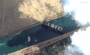 ©MAXAR TECHNOLOGIES VIA AP                                 This satellite image from Maxar Technologies shows the cargo ship MV Ever Given stuck in the Suez Canal near Suez, Egypt, Friday. A maritime traffic jam grew to more than 200 vessels Friday outside the Suez Canal and some vessels began changing course as dredgers worked frantically to free a giant container ship that is stuck sideways in the waterway and disrupting global shipping.