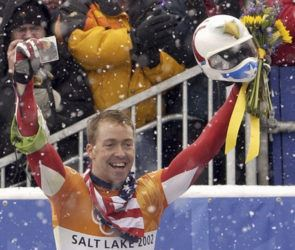 ASSOCIATED PRESS                                 Jimmy Shea of the United States held a photograph of his grandfather, in Feb. 2002, as he celebrated his gold medal-winning run after the men's skeleton final at the Salt Lake City Winter Olympics in Park City, Utah. Shea was charged with sexual abuse of a child in Utah.