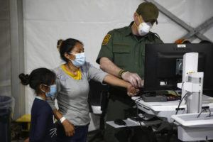 ASSOCIATED PRESS                                 A migrant and her daughter had their biometric data entered at the intake area of the Donna Department of Homeland Security holding facility, the main detention center for unaccompanied children in the Rio Grande Valley, in Donna, Texas, today.