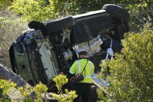 ASSOCIATED PRESS / FEBRUARY 23                                 A vehicle rests on its side after a rollover accident involving golfer Tiger Woods, in Rancho Palos Verdes, Calif., a suburb of Los Angeles.
