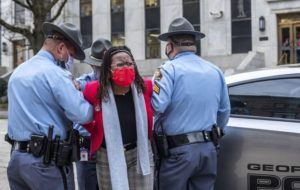 ALYSSA POINTER/ATLANTA JOURNAL-CONSTITUTION VIA ASSOCIATED PRESS                                 State Rep. Park Cannon, D-Atlanta, was placed into the back of a Georgia State Capitol patrol car after being arrested by Georgia State Troopers at the Georgia State Capitol Building in Atlanta, today. Cannon was arrested by Capitol police after she attempted to knock on the door of Gov. Brian Kemp's office.