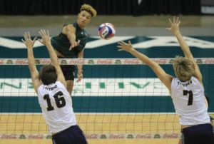 2021 March 27 SPT - Honolulu Star-Advertiser photo by Jamm Aquino/jaquino@staradvertiser.com  Hawaii outside hitter Chaz Galloway (1) puts a kill past UC San Diego middle blocker Shane Benetz (16) and opposite Collin Shannon (7) during the first set of a men's volleyball game on Saturday, March 27, 2021, in Honolulu.  Hawaii swept UC San Diego in three sets.