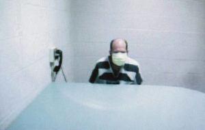 CRAIG T. KOJIMA / CKOJIMA@STARADVERTISER.COM                                 Travis Rodrigues was arraigned Thursday at Circuit Court via videoconference from the Halawa Correctional Facility.