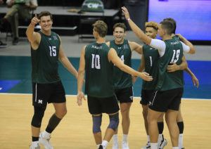 JAMM AQUINO / MARCH 27                                 Hawaii middle blocker Patrick Gasman (15), left, reacts with his teammates.